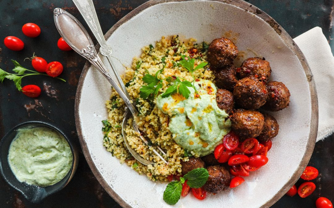 LAMB MEATBALLS WITH HERBED BULGHUL, LIME YOGHURT AND PICKLED TOMATOES